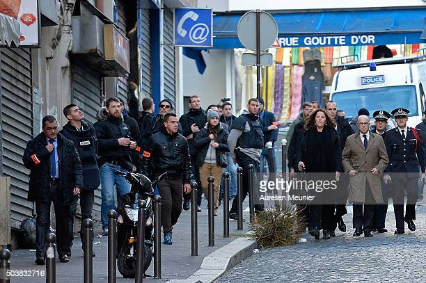 French Minister of Interior Bernard Cazeneuve arrives to the press point next to the police station where a man was shot dead on January 7 2016 in...