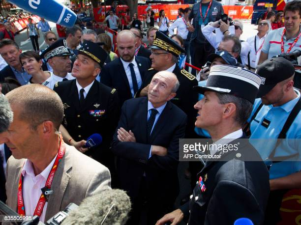 French Minister of Interior Gerard Collomb looks at an unseen police security force drone prior to the start of the first stage of the 72nd edition...