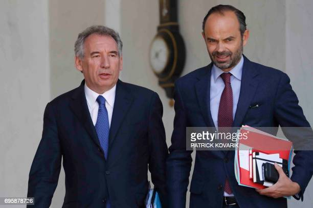 French Minister of Justice Francois Bayrou and French Prime Minister Edouard Philippe leave a cabinet meeting on June 14 2017 at the Elysee Palace in...