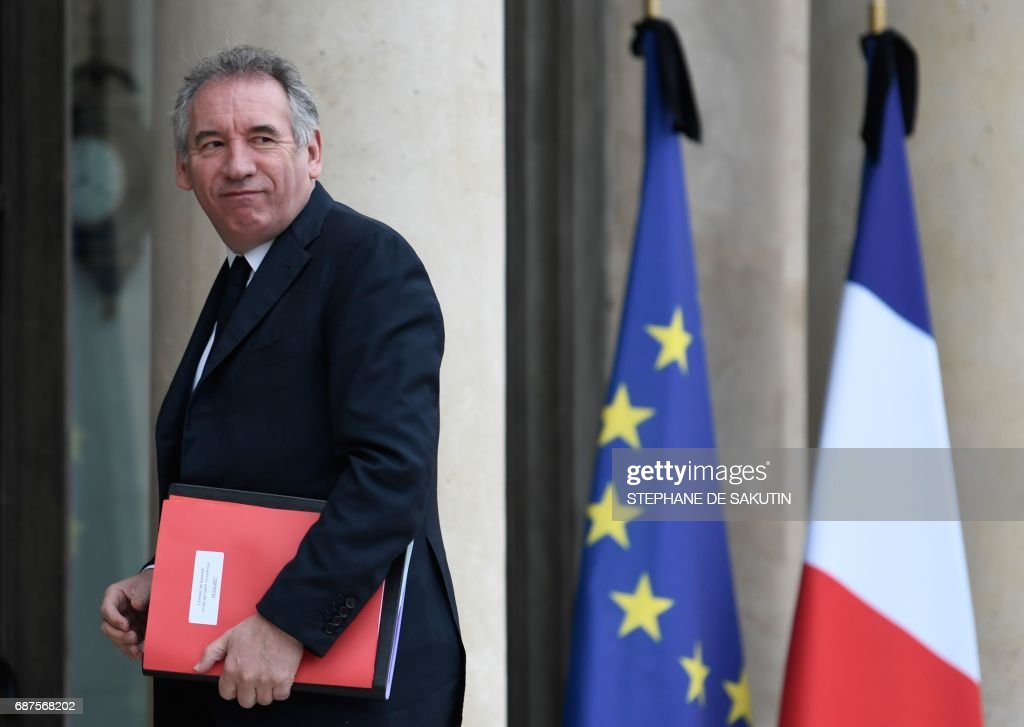 French Minister of Justice Francois Bayrou walks past French and European union flags with black ribbons following the May 22 terror attack in Manchester that killed 22 and injured dozens as he arrives to attend a Defense Council at the Elysee Palace in Paris on May 24, 2017. /