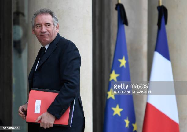French Minister of Justice Francois Bayrou walks past French and European union flags with black ribbons following the May 22 terror attack in...