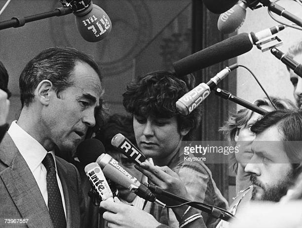 French Minister of Justice Robert Badinter talks to journalists outside the Elysee Palace following a meeting at which he oulined his proposal for...