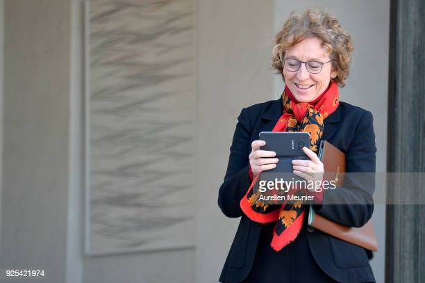French Minister of Labor Muriel Penicaud takes a photo of the photographers as she leaves the Elysee Palace after the weekly cabinet meeting on...