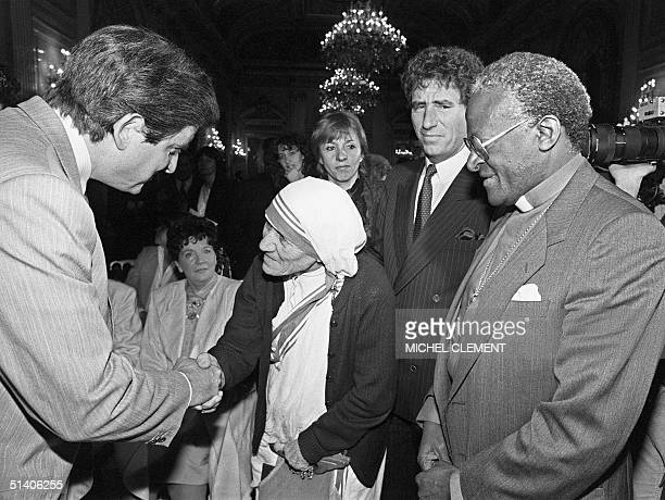 French Minister of National Education JeanPierre Chevenement shakes hands with the 1979 Nobel Peace Prize Mother Teresa during an International...