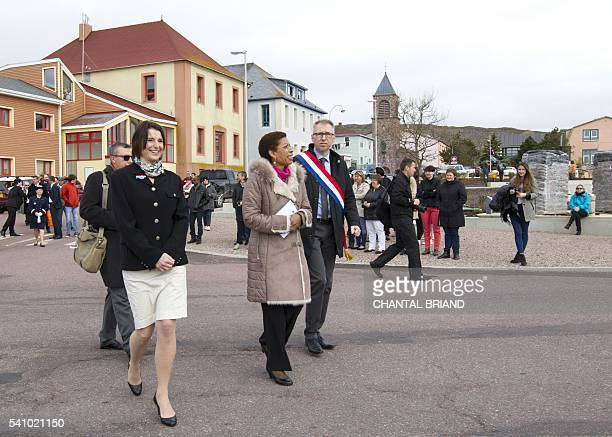 French Minister of Overseas George PauLangevin arrives with 2016 celebrations' president Patricia Detcheverry prior to the unveiling of a plaque to...