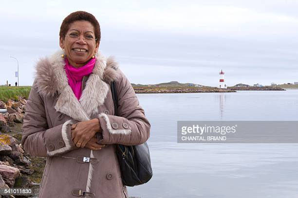 French Minister of Overseas George PauLangevin poses on the small island of L'IleauxMarins in SaintPierre on June 17 2016 during her two days visit...