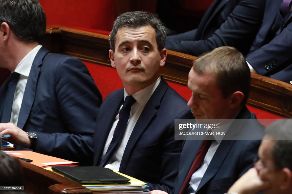 French Minister of Public Action and Accounts Gerald Darmanin (C) attends a session of questions to the government at the National Assembly in Paris on February 21, 2018. /