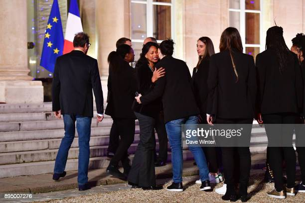 French minister of sport Laura Flessel greets members of the France squad as they arrive for the reception for the France handball women's team at...