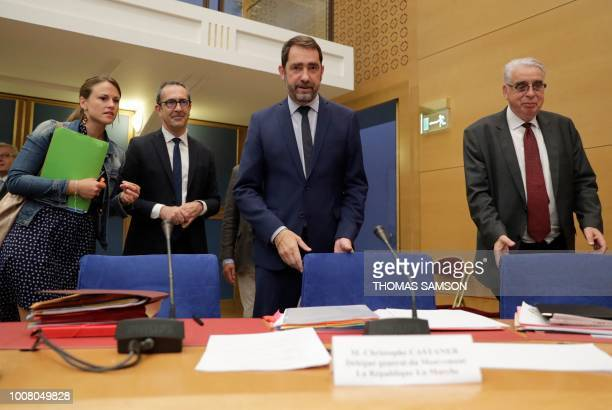 TOPSHOT French Minister of State for Relations with Parliament and centrist party La Republique en Marche head Christophe Castaner flanked by...