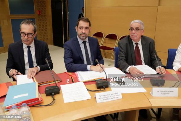 French Minister of State for Relations with Parliament and centrist party La Republique en Marche head Christophe Castaner flanked by JeanPierre...