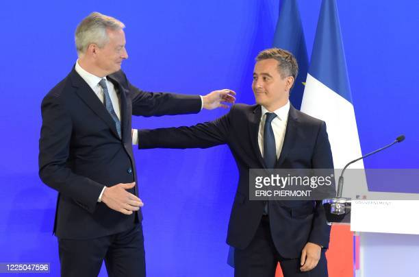 French Minister of the Economy and Finance Bruno Le Maire welcomes newly appointed Interior Minister Gerald Darmanin during the handover ceremony at...