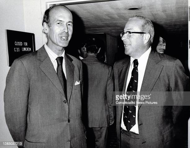 French Minister of the Economy and Finance Valery Giscard d'Estaing talks with US Secretary of the Treasury George P Shultz during an International...