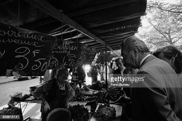 French Minister of the Economy Rene Monory makes a surprise visit to the Edgar Quinet market in Paris to check the prices applied to fruit and...