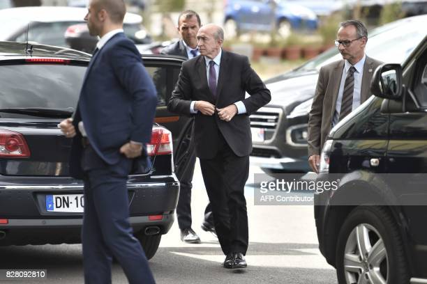 French Minister of the Interior Gerard Collomb arrives at Begin Military Teaching Hospital in SaintMande outside Paris on August 9 where the French...