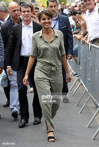 French Minister of Women's Rights and Sports Najat VallaudBelkacem and French Prime Minister Manuel Valls walk back to their cars after giving the...