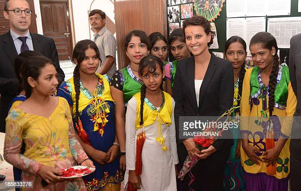 French Minister of Women's Rights Najat VallaudBelkacem poses with Indian women from the Apne Aap Women Worldwide trust in New Delhi on October 25...