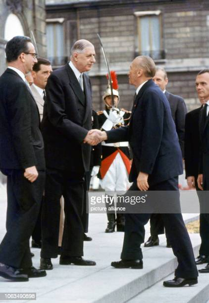 French Minister President Charles de Gaulle welcomes German Chancellor Konrad Adenauer on the stairs of Élysée Palace in Paris. Adenauer was first...