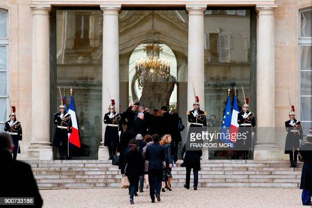 French ministers climb stairs as they arrive at the Elysee presidential palace walking from the Interior Ministry prior to the year's first Cabinet...
