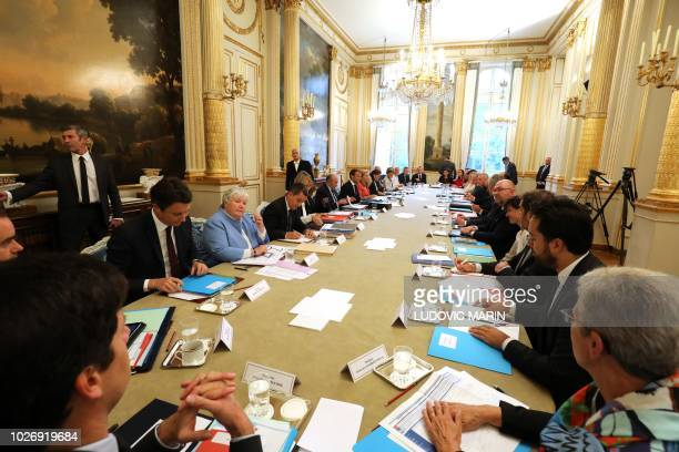 French ministers take part in the weekly cabinet meeting at the Elysee Palace on September 5 in Paris following a government reshuffle the day before...