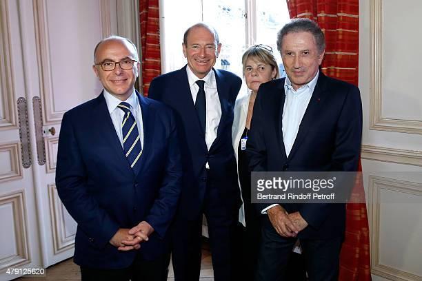 French Ministre de l'Interieur Bernard Cazeneuve Producer Tim Newman Producer Dominique Cantien and Presenter of the show Michel Drucker attend the...