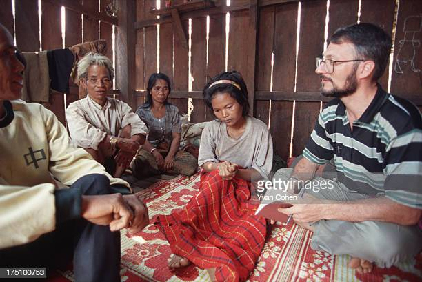 BOUSRA MONDOLKIRI CAMBODIA French missionary Gerald Vogin leads a prayer session to bless a young Phnong girl suffering from depression A small group...