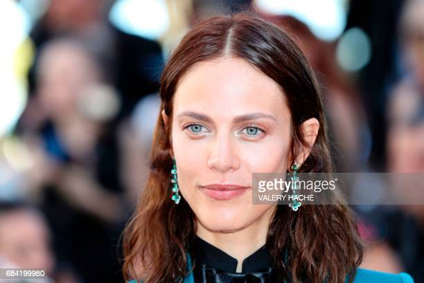 French model and actress Aymeline Valade poses as she arrives on May 17 2017 for the screening of the film 'Ismael's Ghosts' during the opening...