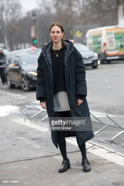 French model and actress Aymeline Valade wears a Paco Rabanne sweater dress and shoes day 4 of Paris Womens Fashion Week Spring/Summer 2018 on March...