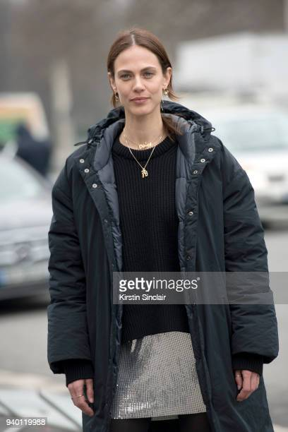 French model and actress Aymeline Valade wears a Paco Rabanne sweater and dress day 4 of Paris Womens Fashion Week Spring/Summer 2018 on March 1 2018...