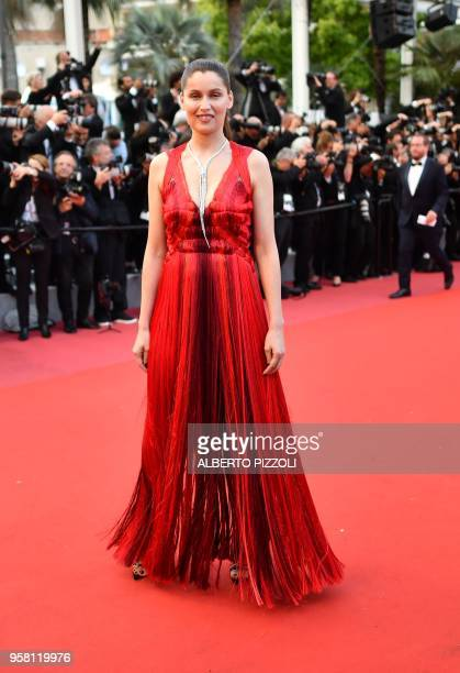 French model and actress Laetitia Casta poses as she arrives on May 13 2018 for the screening of the film Sink Or Swim at the 71st edition of the...