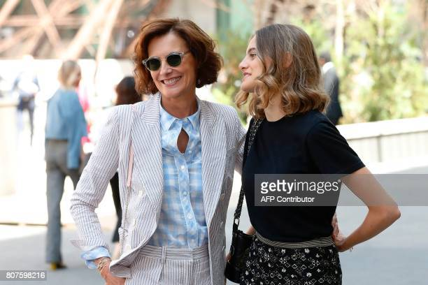 French model and fashion designer Ines de la Fressange and her daughter Violette pose during the photocall before Chanel 20172018 fall/winter Haute...
