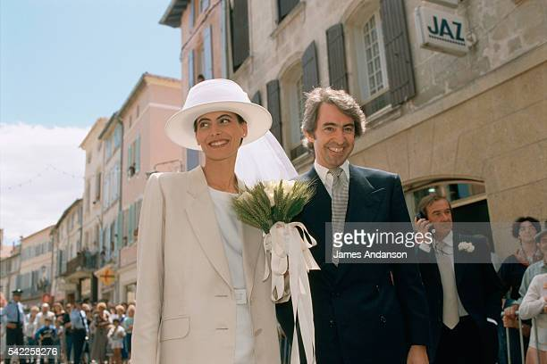 French model and fashion designer Ines de La Fressange and Luigi d'Urso walking towards the town hall of Tarascon for their wedding ceremony After...