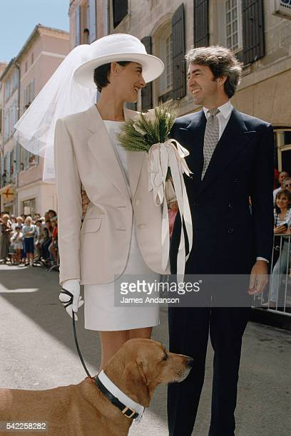 French model and fashion designer Ines de La Fressange and Luigi d'Urso walking towards the town hall of Tarascon with their dog for their wedding...