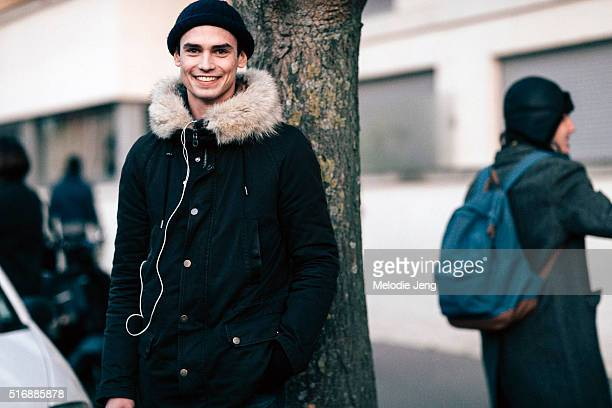 French model Arthur Gosse wears a black sailor beanie and black parka with a fur collar after the Louis Vuitton show on Day 2 of Paris Fashion Week...