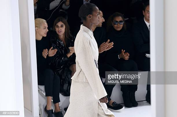 French model Aymeline Valade French fashion editor Carine Roitfeld US singer Janet Jackson and husband Wissam Al Mana watch a model presenting Hermes...