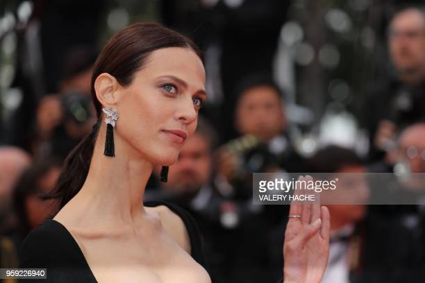 French model Aymeline Valade poses as she arrives on May 16 2018 for the screening of the film 'Burning' at the 71st edition of the Cannes Film...