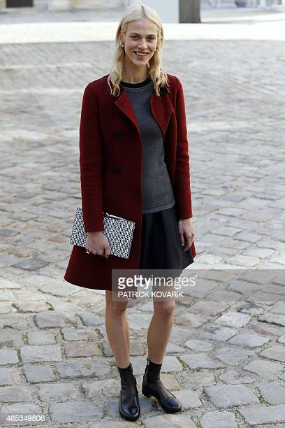 French model Aymeline Valade poses prior to attend Christian Dior 20152016 fall/winter readytowear collection fashion show on March 6 2015 in Paris...
