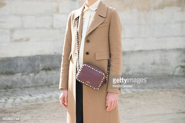 French Model Aymeline Valade wears a Valentino bag on day 8 during Paris Fashion Week Autumn/Winter 2016/17 on March 8 2016 in Paris France Aymeline...