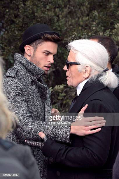 French model Baptiste Giabiconi talks with German designer Karl Lagerfeld during the Chanel Haute Couture SpringSummer 2013 collection shows on...