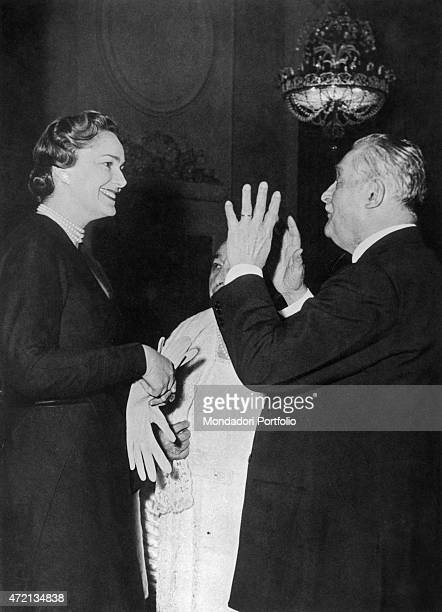 French model Begum Om Habibeh Aga Khan fourth wife of Imam of the Nizari Ismaili community Aga Khan III smiling in front the owner of the casino of...