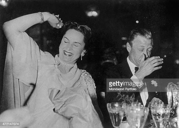 French model Begum Om Habibeh Aga Khan fourth wife of Imam of the Nizari Ismaili community Aga Khan III having fun in a club beside Edward VIII Paris...
