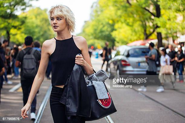 French model Celine Bouly wears the sparkly glitter lipstick from the Fendi show by Peter Philips a sleeveless knit top and a black Karl Lagerfeld...