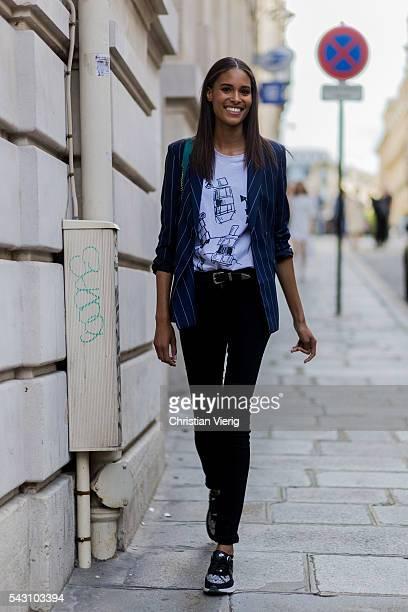 French model Cindy Bruna outside Balmain during the Paris Fashion Week Menswear Spring/Summer 2017 on June 25 2016 in Paris France