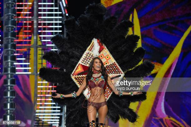 French model Cindy Bruna presents a creation during the 2017 Victoria's Secret Fashion Show in Shanghai on November 20 2017 / AFP PHOTO / FRED DUFOUR...