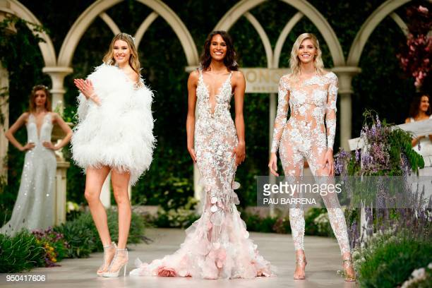 TOPSHOT French model Cindy Bruna presents a creation of the Pronovias 2019 collection during the Barcelona Bridal Week in Barcelona on April 23 2018