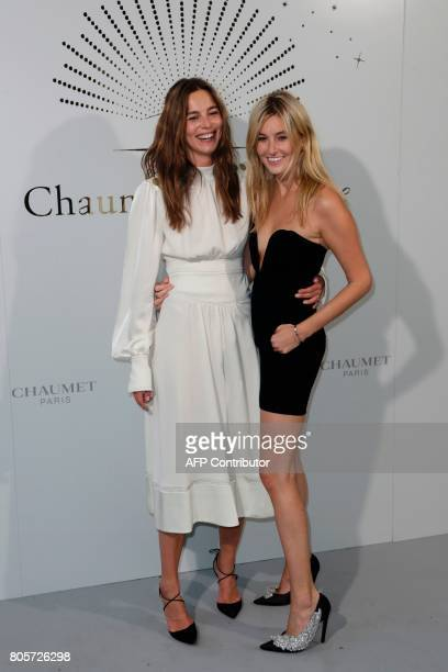French model Eleonore Toulin and French blogger Camille Charriere pose during a photocall as part of an event organised by French jeweller Chaumet on...