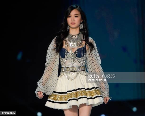 French model Estelle Chen presents a creation during the 2017 Victoria's Secret Fashion Show in Shanghai on November 20 2017 / AFP PHOTO / FRED...