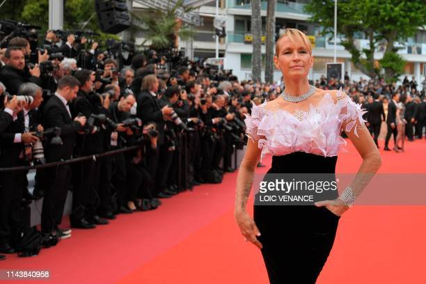 French model Estelle Lefebure poses as she arrives for the screening of the film The Dead Don't Die during the 72nd edition of the Cannes Film...
