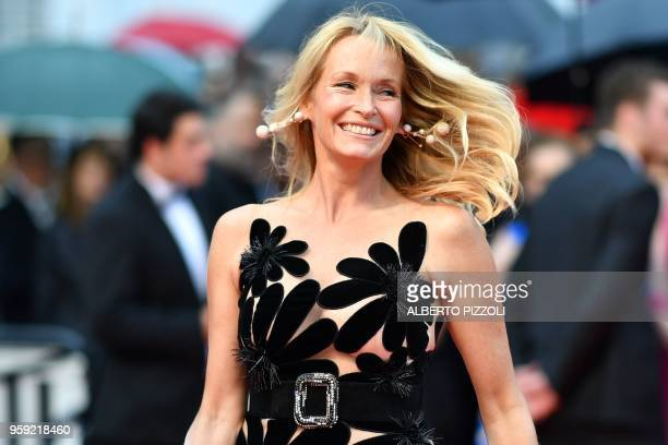 French model Estelle Lefebure poses as she arrives on May 16 2018 for the screening of the film Burning at the 71st edition of the Cannes Film...