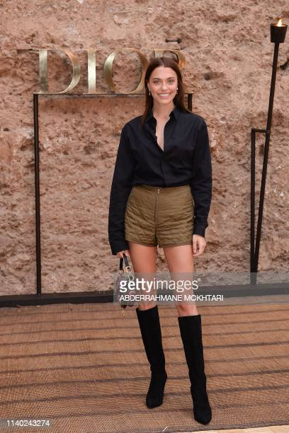 French model Heloise Agostinelli attends the Christian Dior Croisiere 2020 collection fashion show at Badi palace in the Moroccan city of Marrakesh...