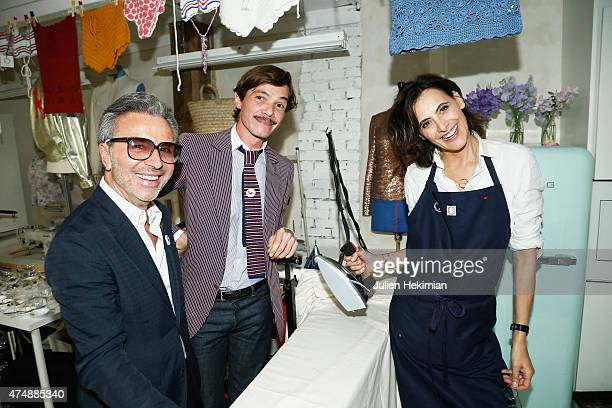 French model Ines de la Fressange attends her boutique opening with French designer Elie Top and Guerlain creative director Olivier Echaudemaison on...
